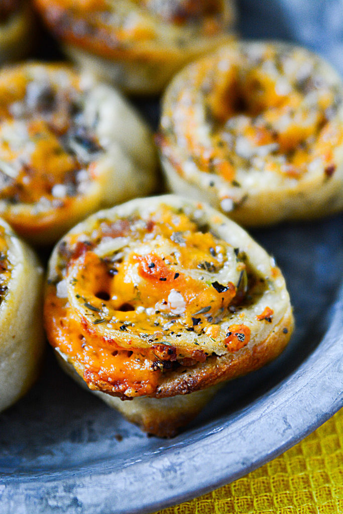 These bacon cheddar wheels with garlic butter topping are absolutely amazing!!