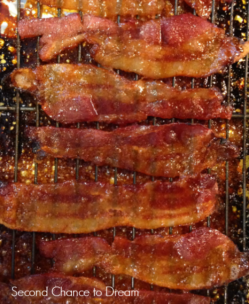 slices of candied bacon on a rack. The bacon looks crispy