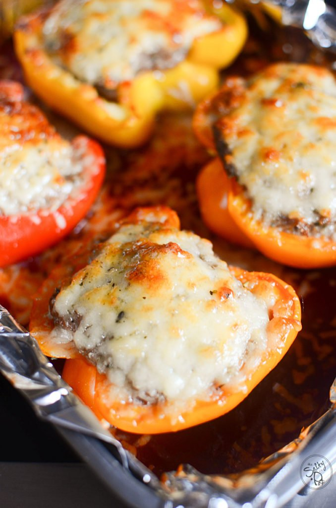 Savory sausage stuffed sweet peppers baked with melty parmesan cheese, yummm!