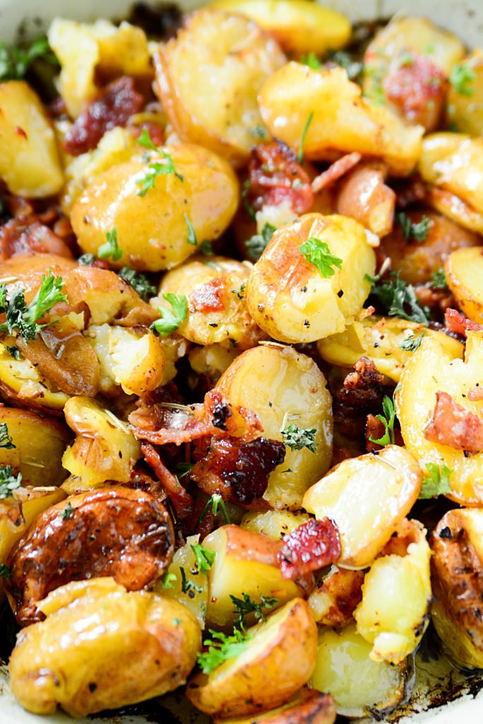 Best bacon recipes ever - Crispy, buttery, smoky, salty, herb-y  roasted potatoes in a dish with bacon and rosemary
