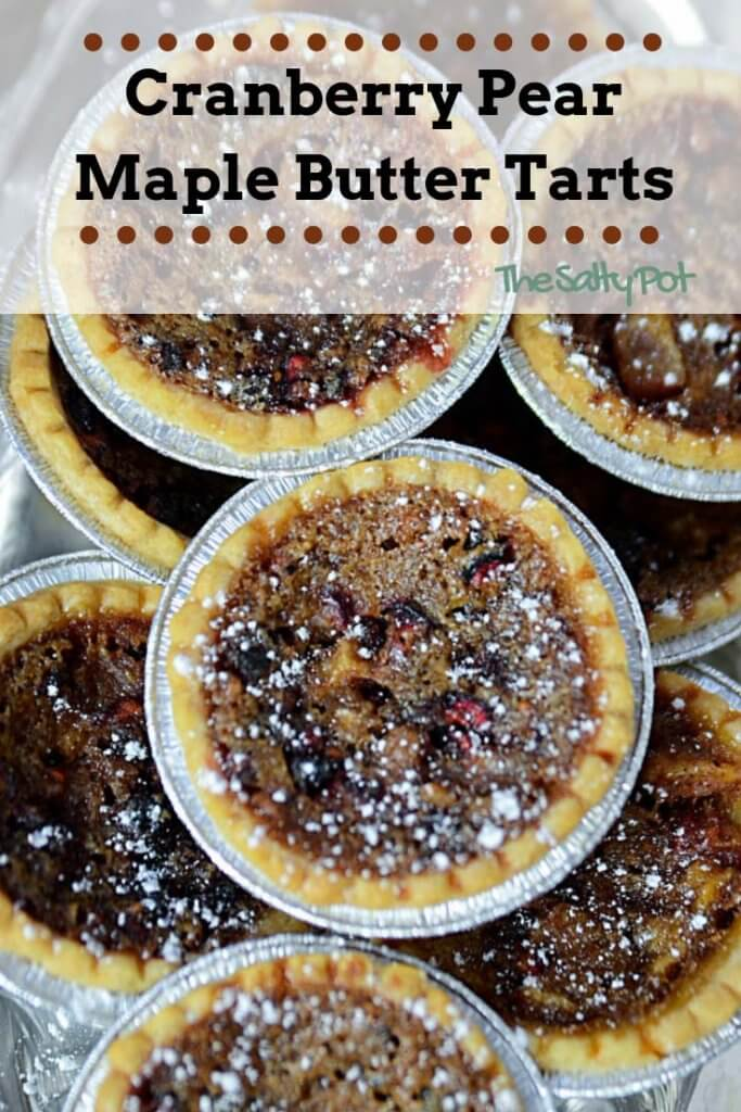 These cranberry pear maple butter tarts will seriously kick you into the christmas spirit! They are kind of like a pecan pie, but miniature and way more delicious! Maple butter tarts are the epitome of what a butter tart should taste like with cranberries and pear joining the party!