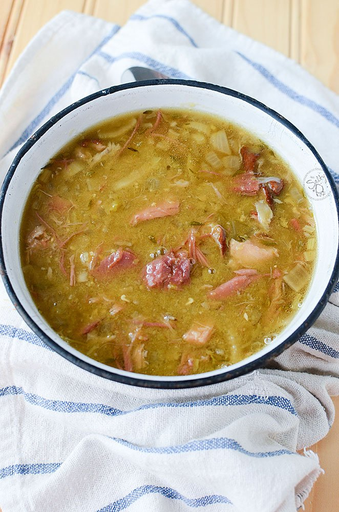 Slow cooker Smoked Pork Hock Soup with Peas. Smoky and hearty, this ham hock soup is filled with amazing flavor that's frugal to make and tasty to eat. Much like your holiday ham and split pea soup, this soup has a smokier pork flavor and texture. This hearty bowl of smoked ham hock soup with peas is ready for eating!