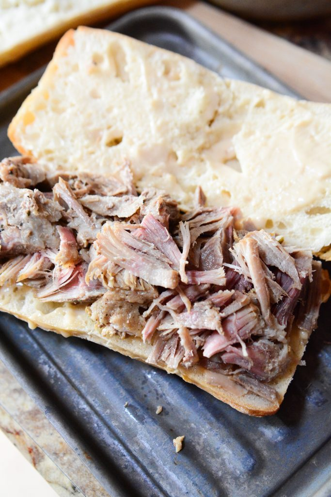 This Instant Pot Mississippi Pulled Pork Dip is a twist on the classic Mississippi Pot Roast, traditionally done with beef, is made super quick in the Instant Pot with a pork roast instead!! Shredded pulled pork made delicious into a bun, with cheese, and dipping au jus or juice. It's the perfect sandwich!!
