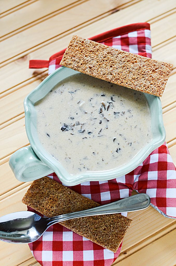 This slow cooker creamy mushroom soup is best served with sides of crackers or crusty bread. The bowl of soup pictured here has to crispy crackers that are perfect for dipping!