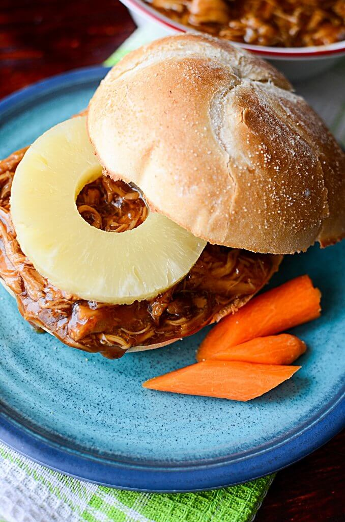 This Crock Pot Teriyaki Chicken Recipe is perfect served on buns with a slice of pineapple! Even picky eaters will love this slow cooker chicken dish!