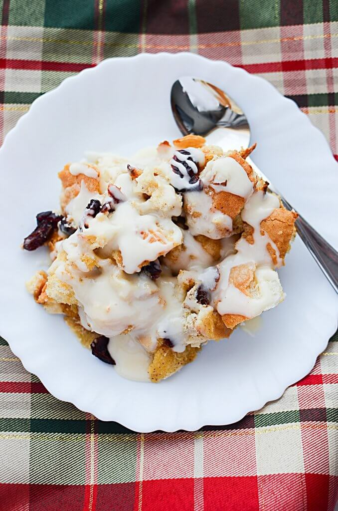 Warm,comforting Eggnog Bread Pudding with Cranberries is a perfect way to start Christmas morning! Best of all, make it the night before & bake in the A.M.! - The Salty Pot
