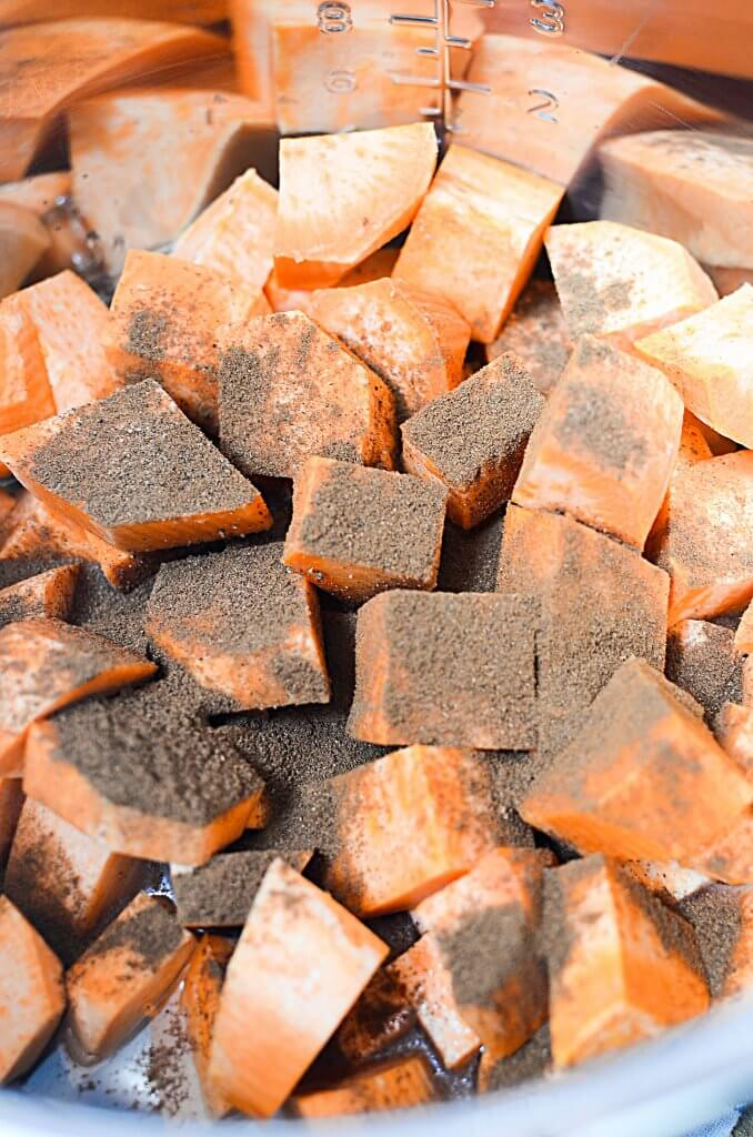 Raw sweet potato cubes sprinkled with cinnamon