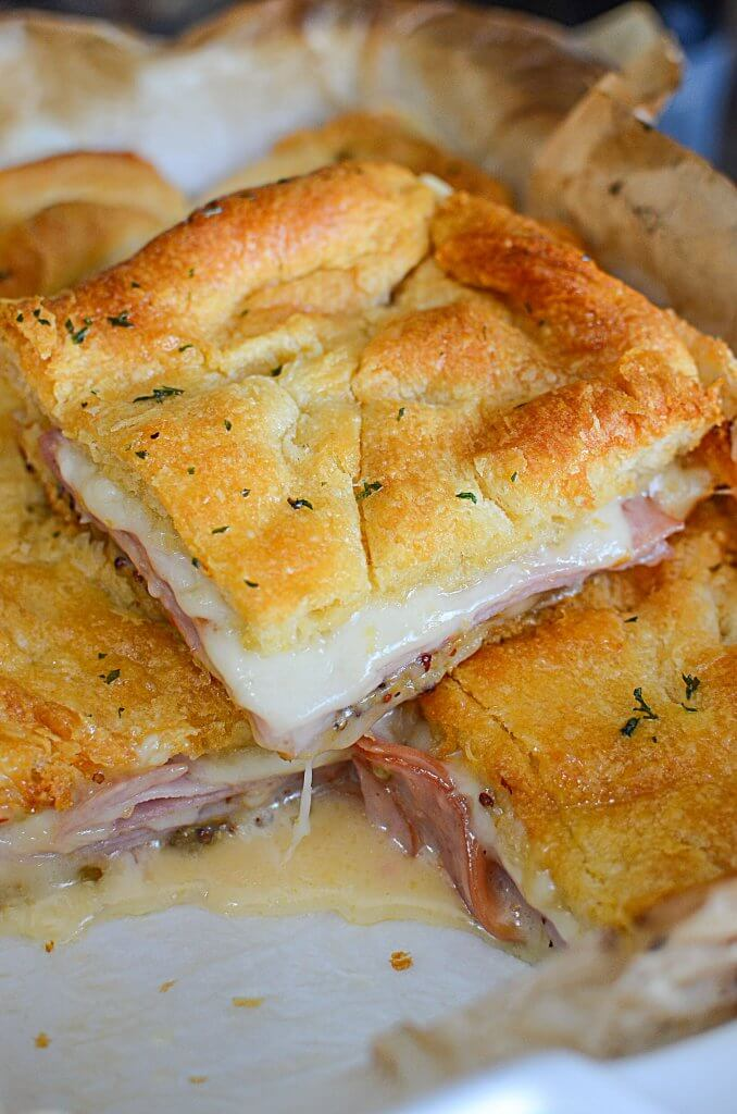 These are the easiest hot ham and cheese sandwiches you'll ever make for dinner! These aren't your typical loaf of bread ham and cheese sandwich! Check them out! - The Salty Pot