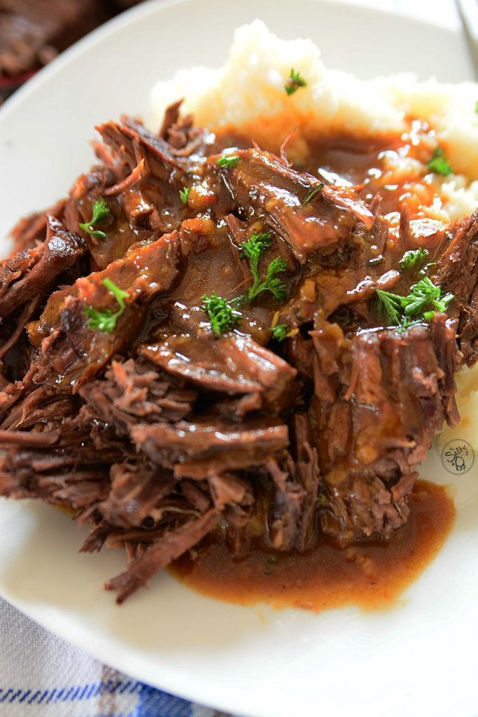 Instant pot 3 packet roast. Yummy, beef roast morsels with a rich beefy gravy, all over creamy mashed potatoes!