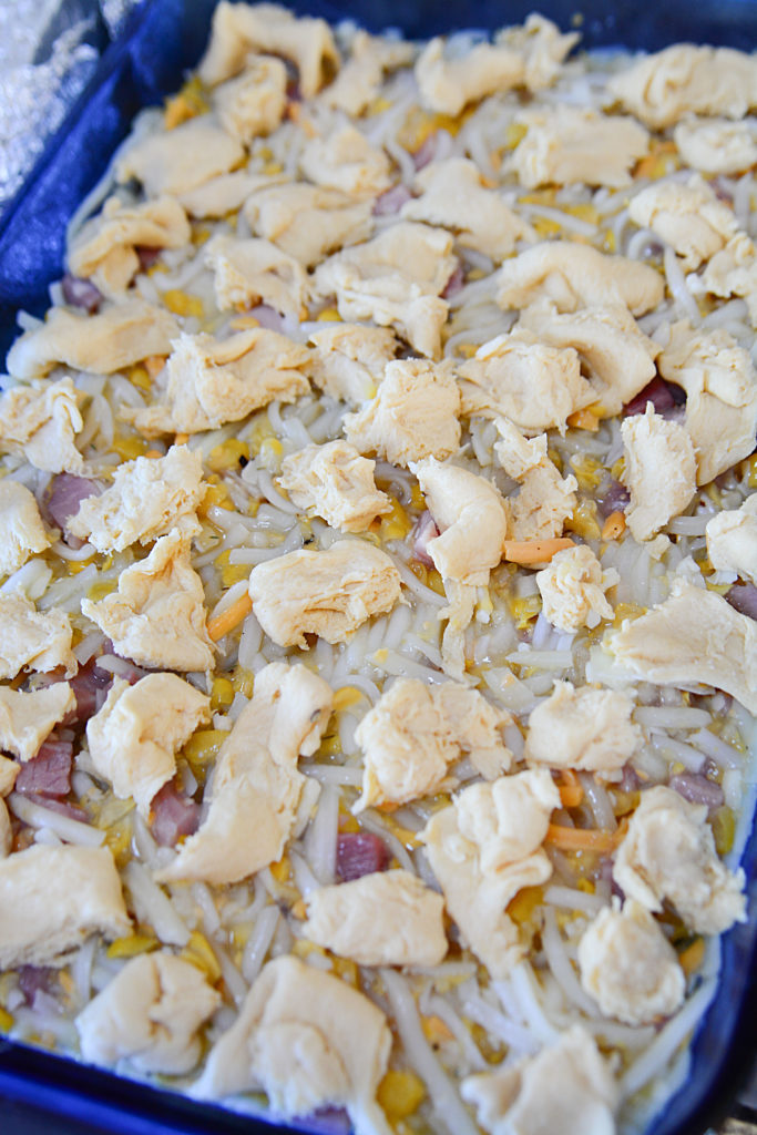 Pieces of yummy biscuits topping this ham and hashbrown casserole