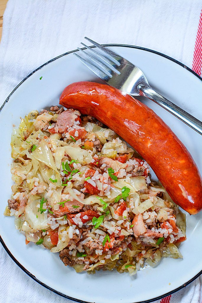 a plate of lazy cabbage rolls with sausage