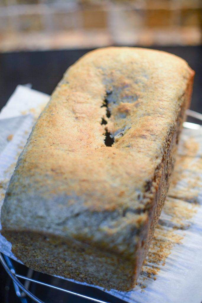 a banana loaf fresh from oven with the center having a crack