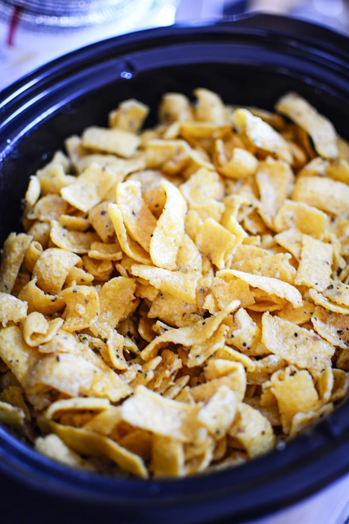 Chips topped with seasonings in a large blue bowl
