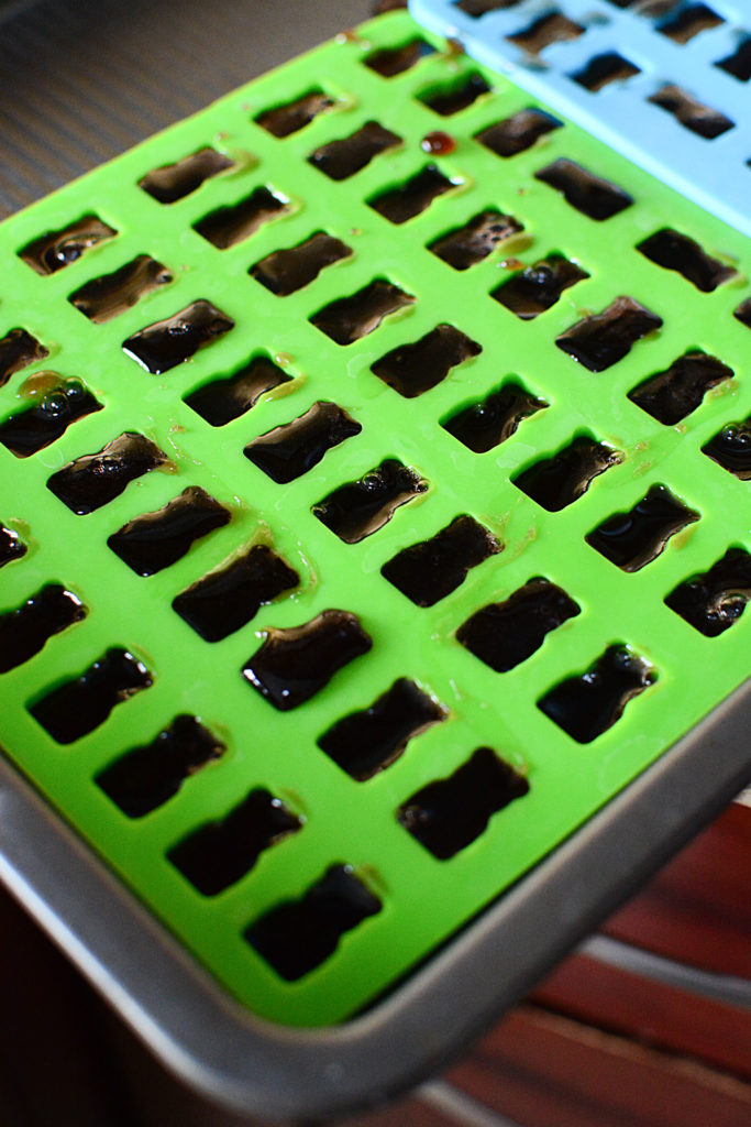 green gummy bear silicon mold with elderberry syrup