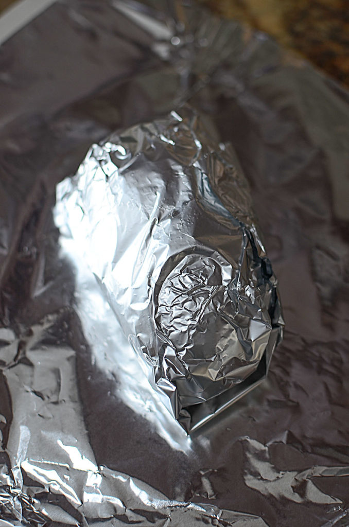 An image of a potato wrapped in foil