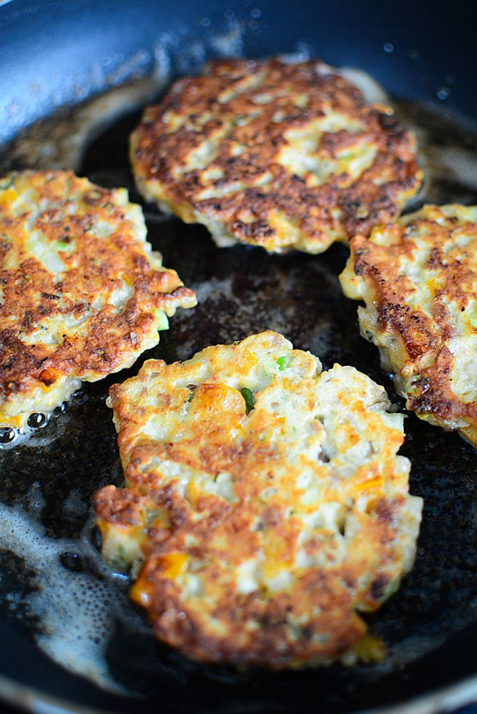 These potato patties are frying on the other side, with the side up showing a nice crispy crust