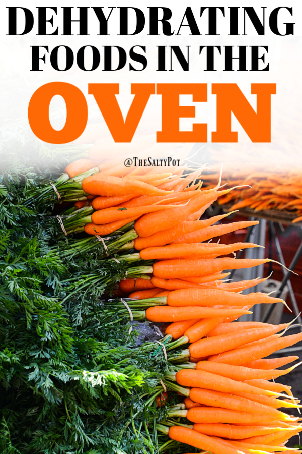 A huge stack of fresh carrots on a wooden table.