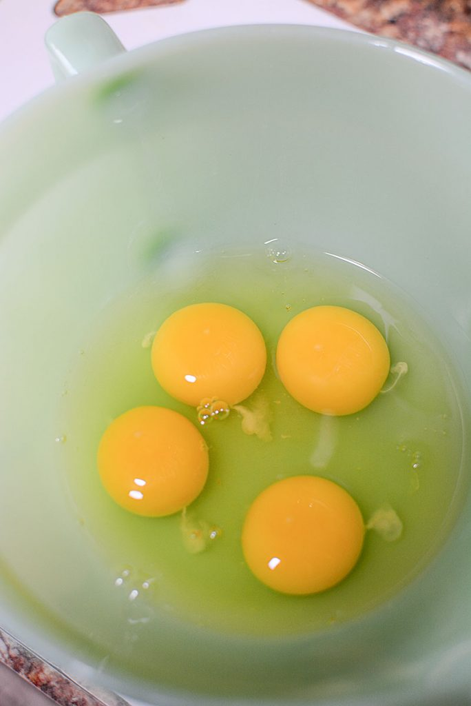 4 whole eggs cracked in my grandmothers vintage mixing bowl!
