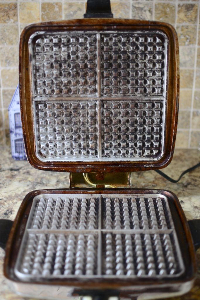 A photo of the inside of the Vintage Sunbeam Waffle Iron of my mom's.