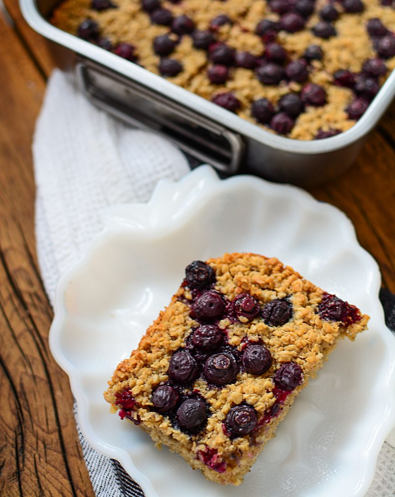 This blueberry oatmeal bar served on a pretty plate is easy to make and even easier to take with you if you're busy!!