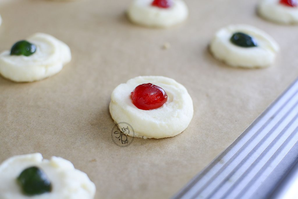Just look at those little red and green stoplight shortbread cookies just about to go into the oven! Adorable!