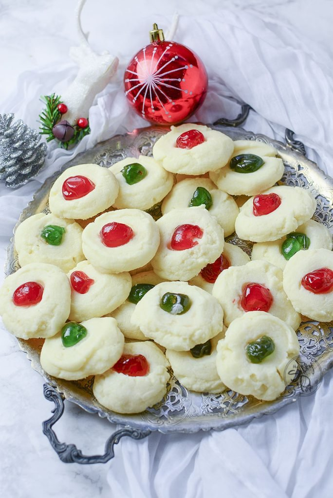 These delicious whipped shortbread cookies look so pretty served on a silver platter with little christmas decorations around them!