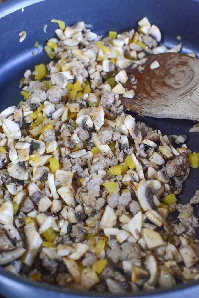 The sausage mixture ready for the cheese to be added to the fry pan.