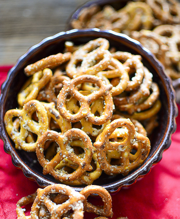 These seasoned pretzel recipe makes a lot! The two bowls are overflowing and there is still A LOT in the crock pot waiting!