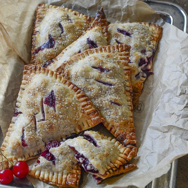 These pretty hand pies displayed in a vintage silver tray with rustic paper around them scream rustic deliciousness!